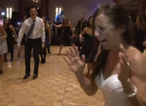 Thumbnail image for Brides Priceless Reaction to Guests Flash Mob Dance